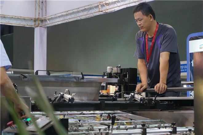 上海三印最新不停机WPT1050全自动停回转滚筒式平型网版印刷机精彩亮相第30届网印展
